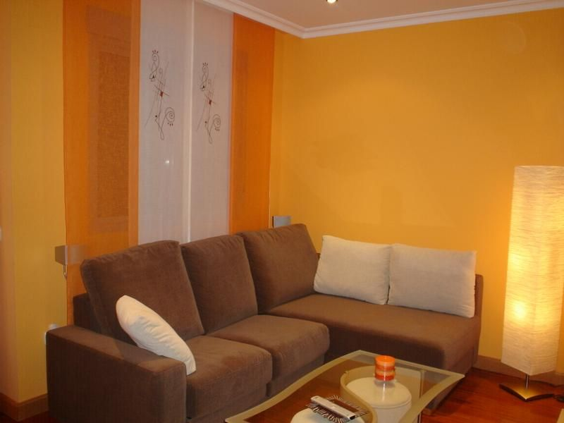 cortinas en habitacion naranja