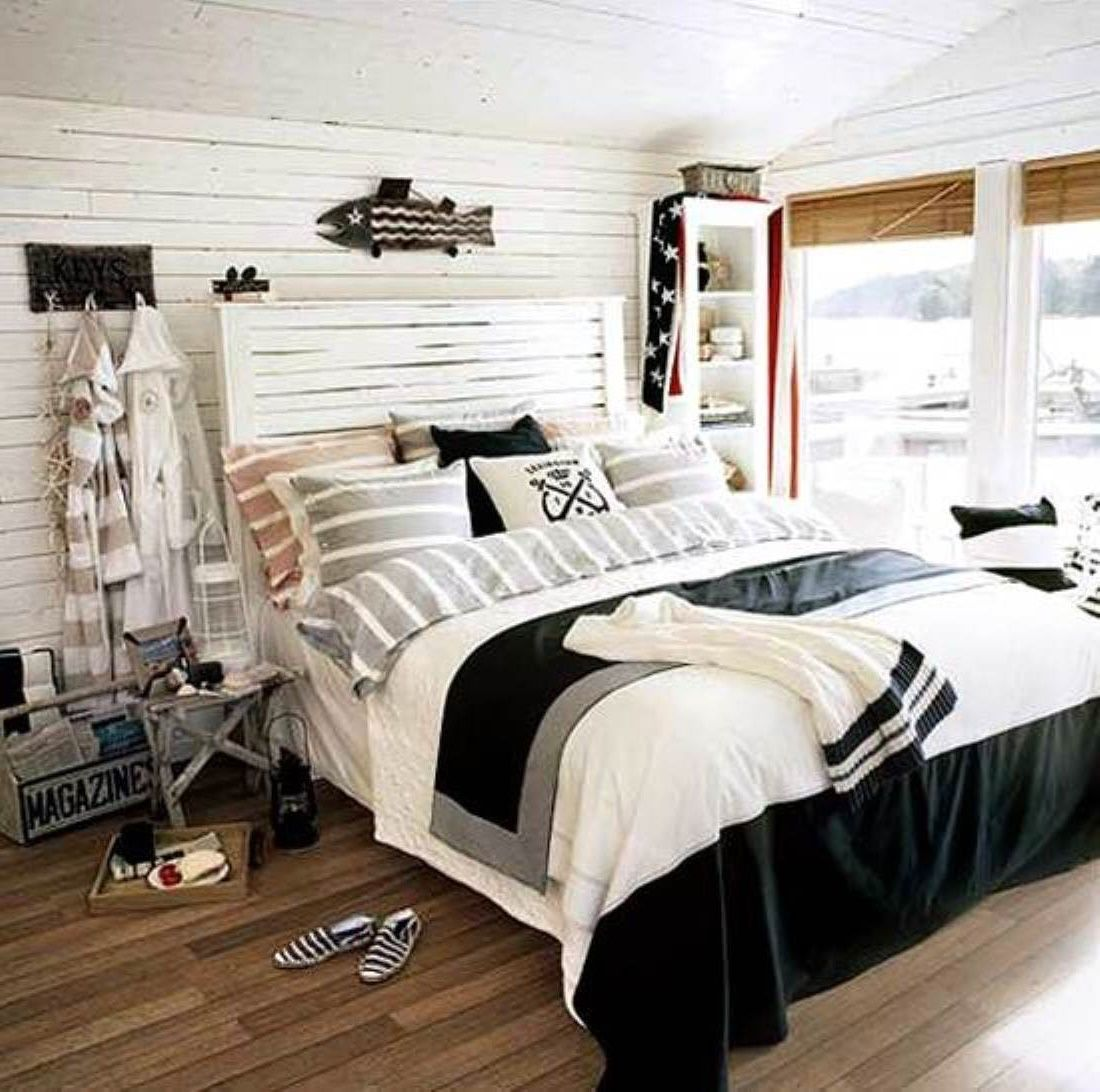 Funny Nautical Bedroom For Kid With Black Fish On The White Wall ...