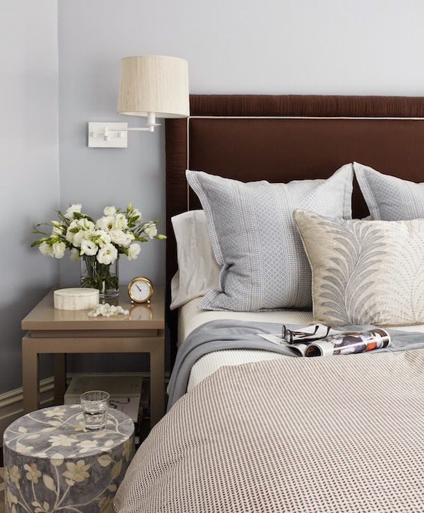 Gorgeous Blue And Brown Bedroom Features Gray Walls Framing A Velvet Headboard With White Piping On Queen Bed Dressed In Bedding