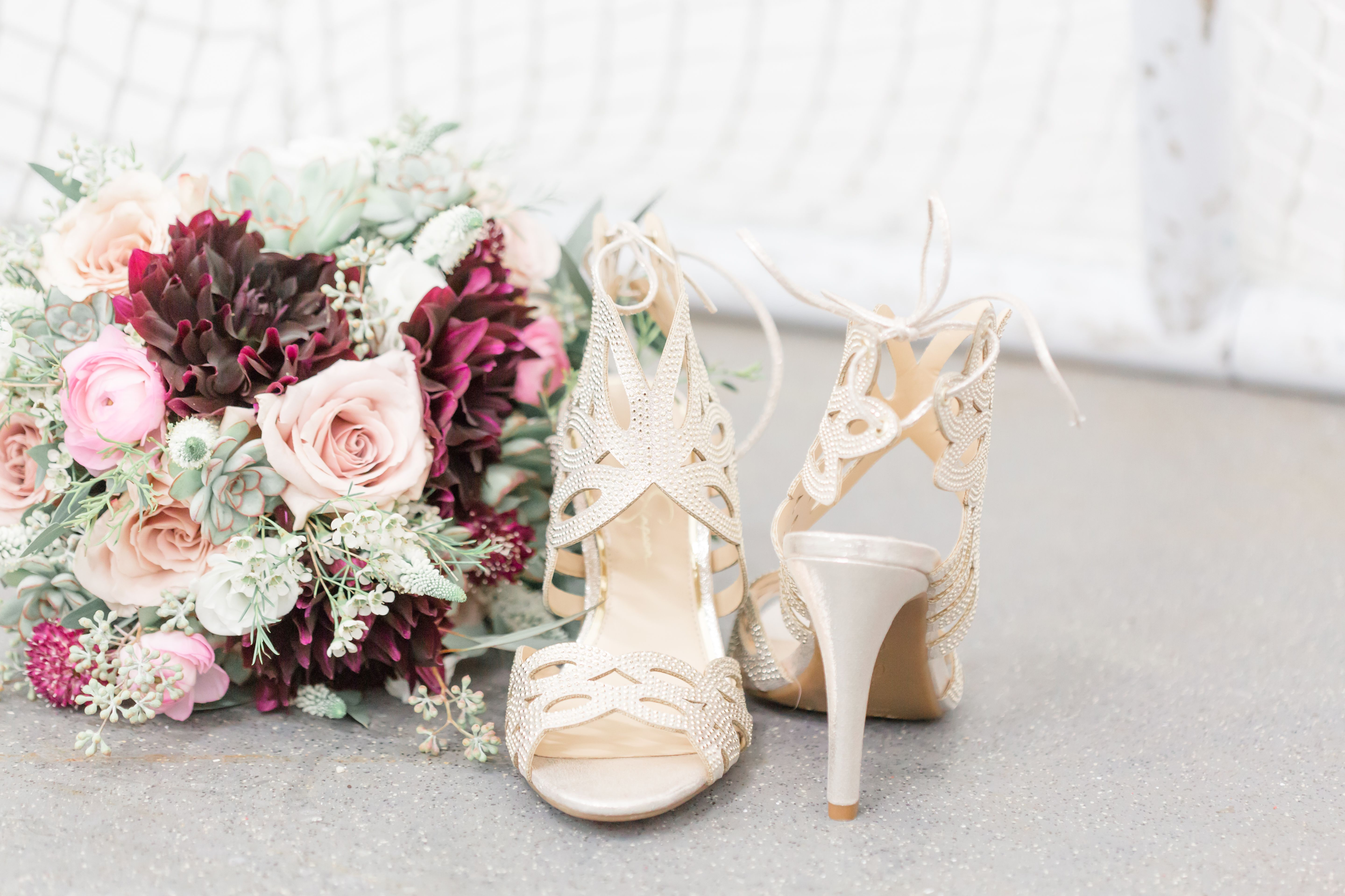 My bridal bouquet and heels with a hockey net backdrop ...