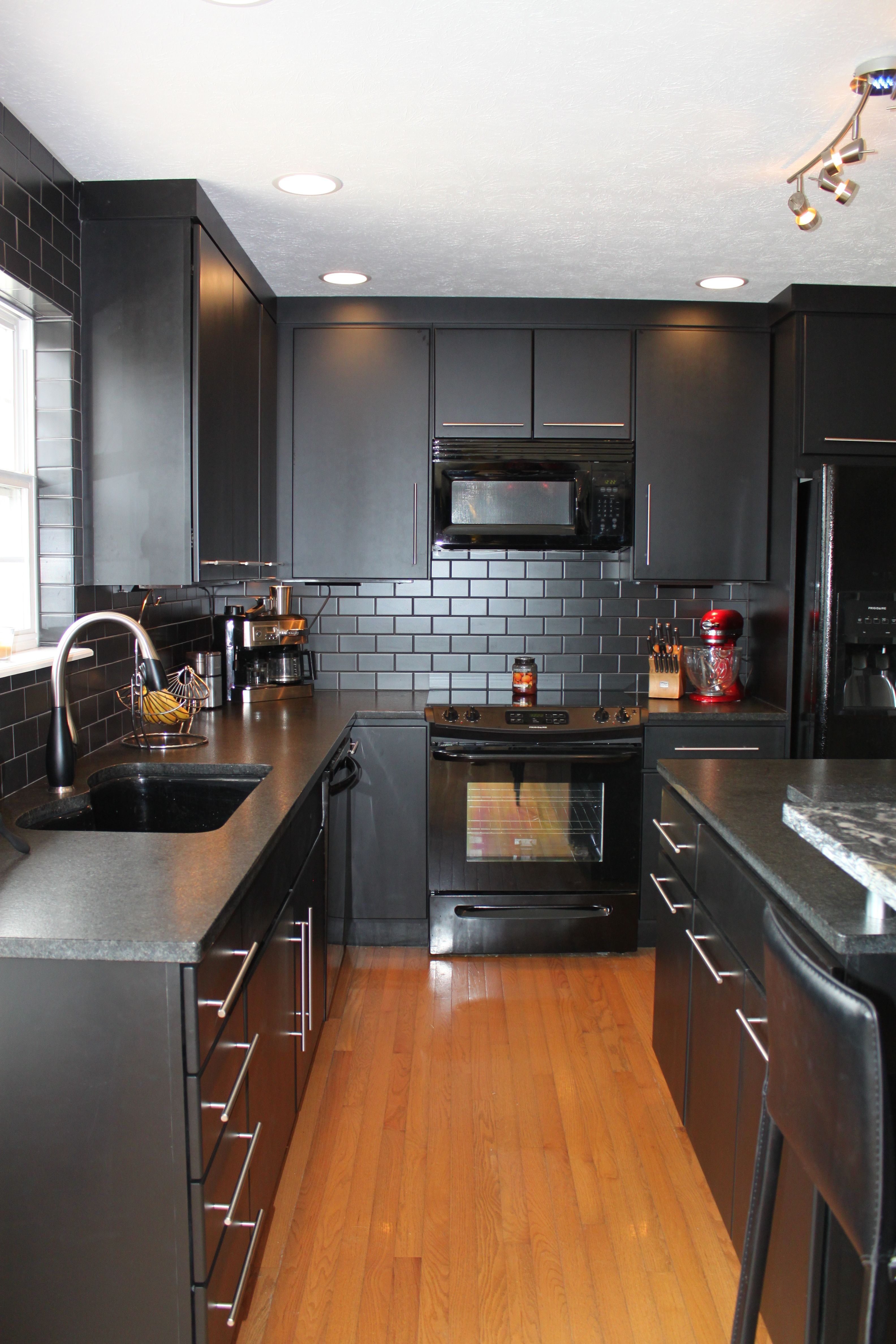 Kitchen With Black Cabinets By Bertch Kitchens Kitchen And Bath