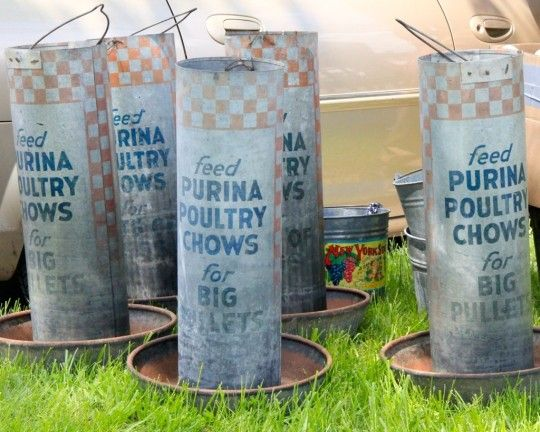 May 2014 FOUND FLEA - Fabulous galvanized chicken feeders with great advertising! Wouldn't these make great planters!