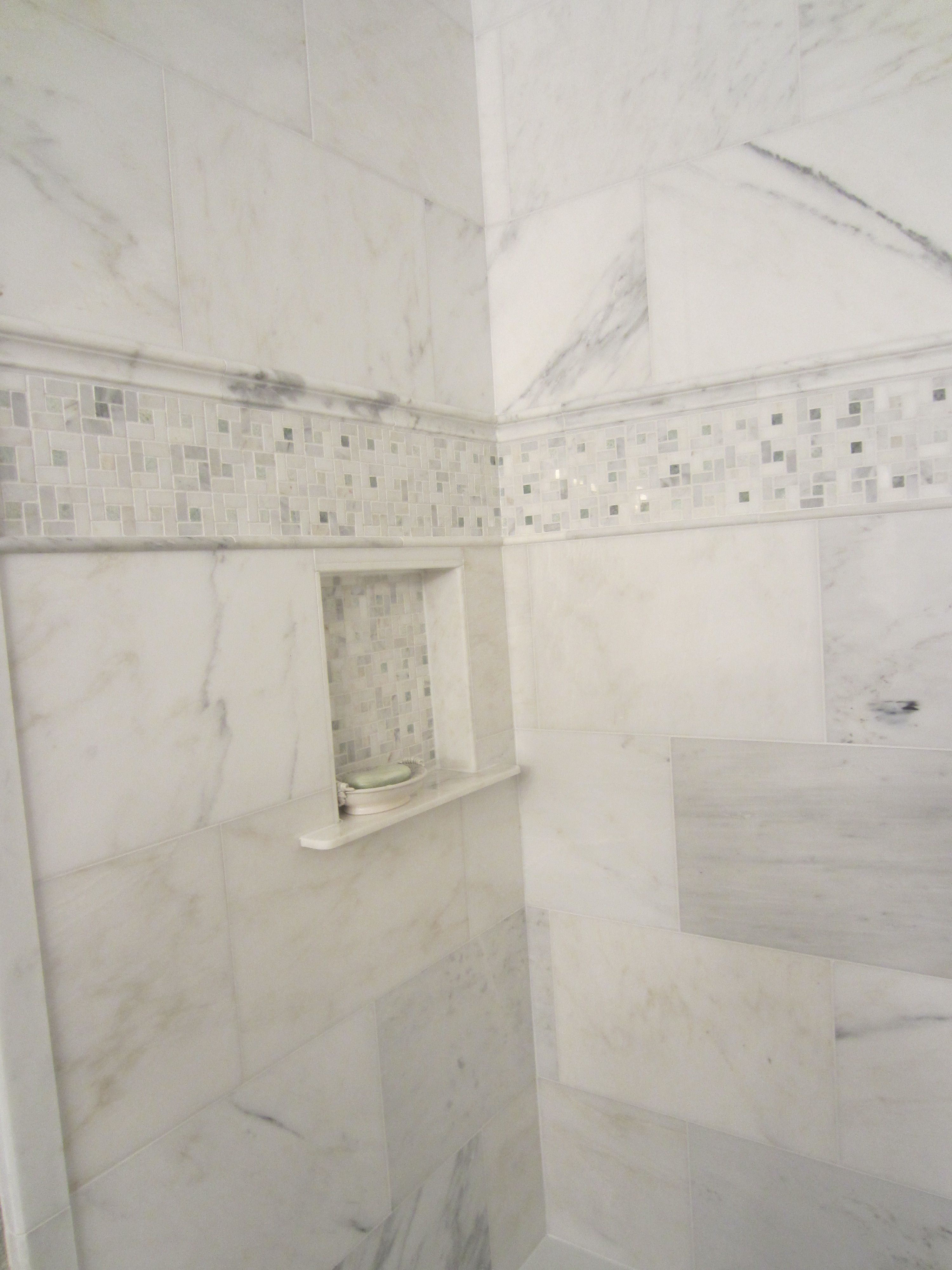Decorative Accent Tiles For Bathroom Entrancing Carrara Mable Tiles With Decorative Accent And Builtin Niche Design Ideas