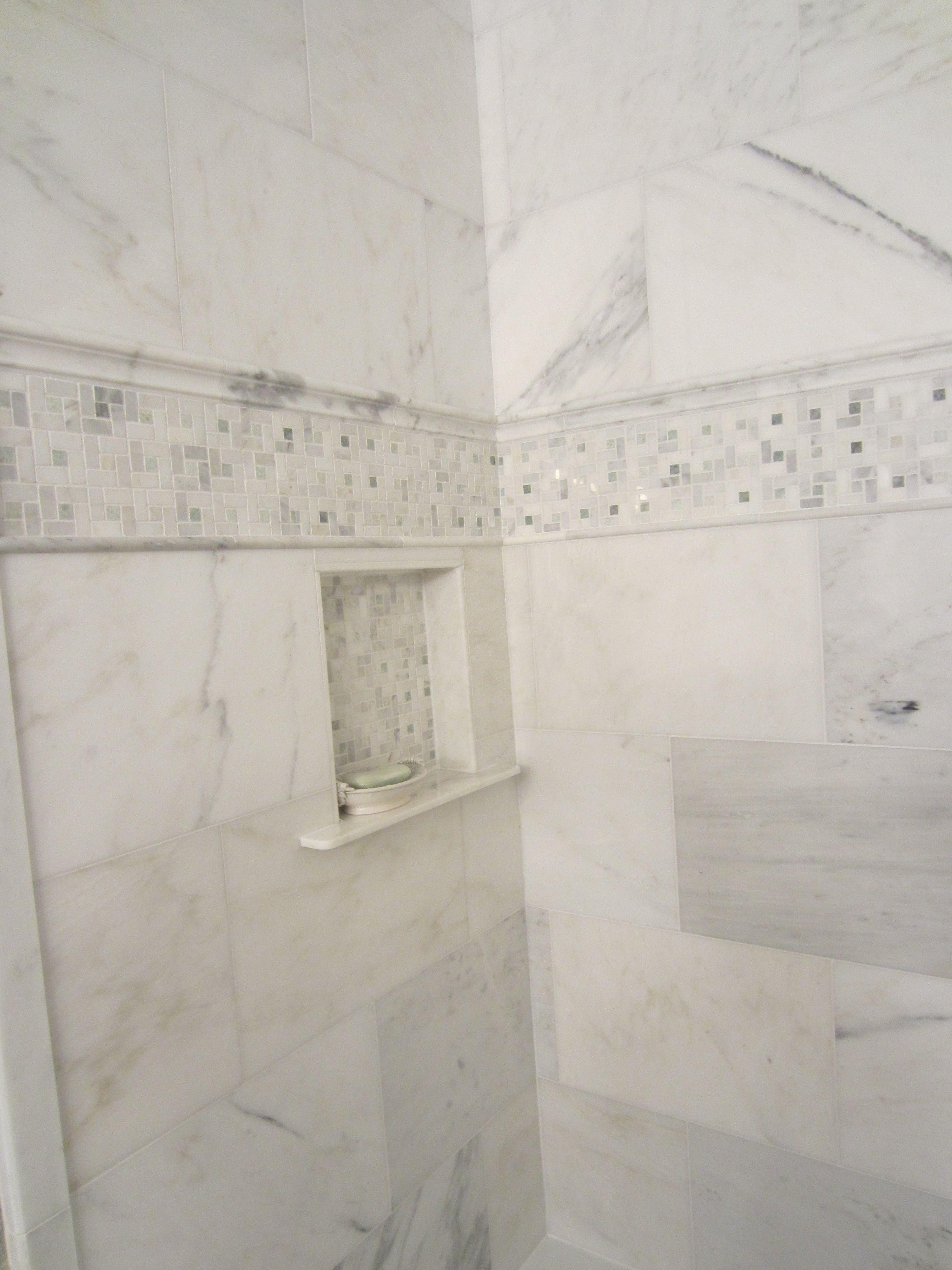 Decorative Accent Tiles For Bathroom Carrara Mable Tiles With Decorative Accent And Builtin Niche
