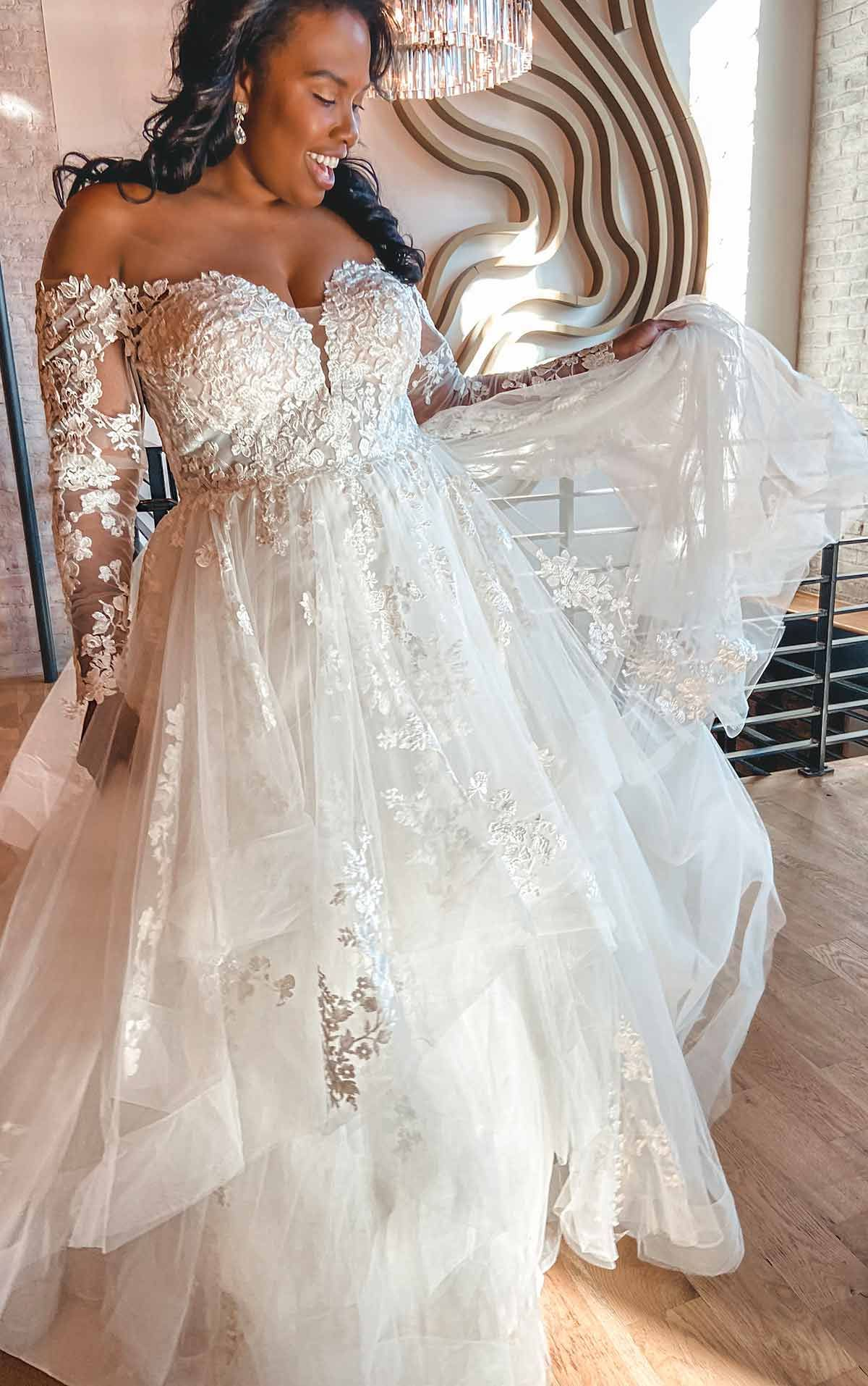 Off Shoulder Long Sleeve Lace Plus Size Ballgown With Tiered Skirt In 2020 Essense Of Australia Wedding Dresses Ball Gowns Ball Gown Wedding Dress [ 1914 x 1200 Pixel ]