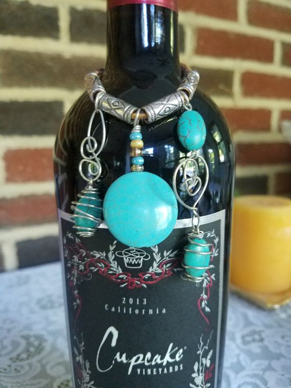 This Wine Bottle Charm Is Perfect To Dress Up Your Wine Bottle The Charm Is A Combination Of Turquoise Circ Wine Bottle Charms Bottle Charms Wine Bottle Decor