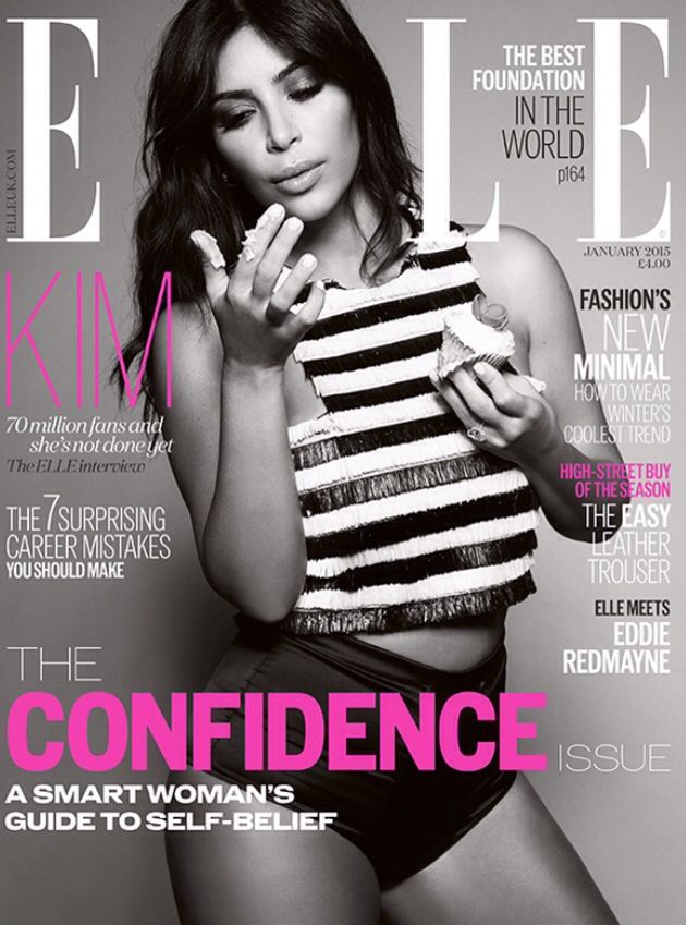 Kim Kardashian West on the ELLE UK cover for January 2015 wearing Balmain, eating a cupcake Xx