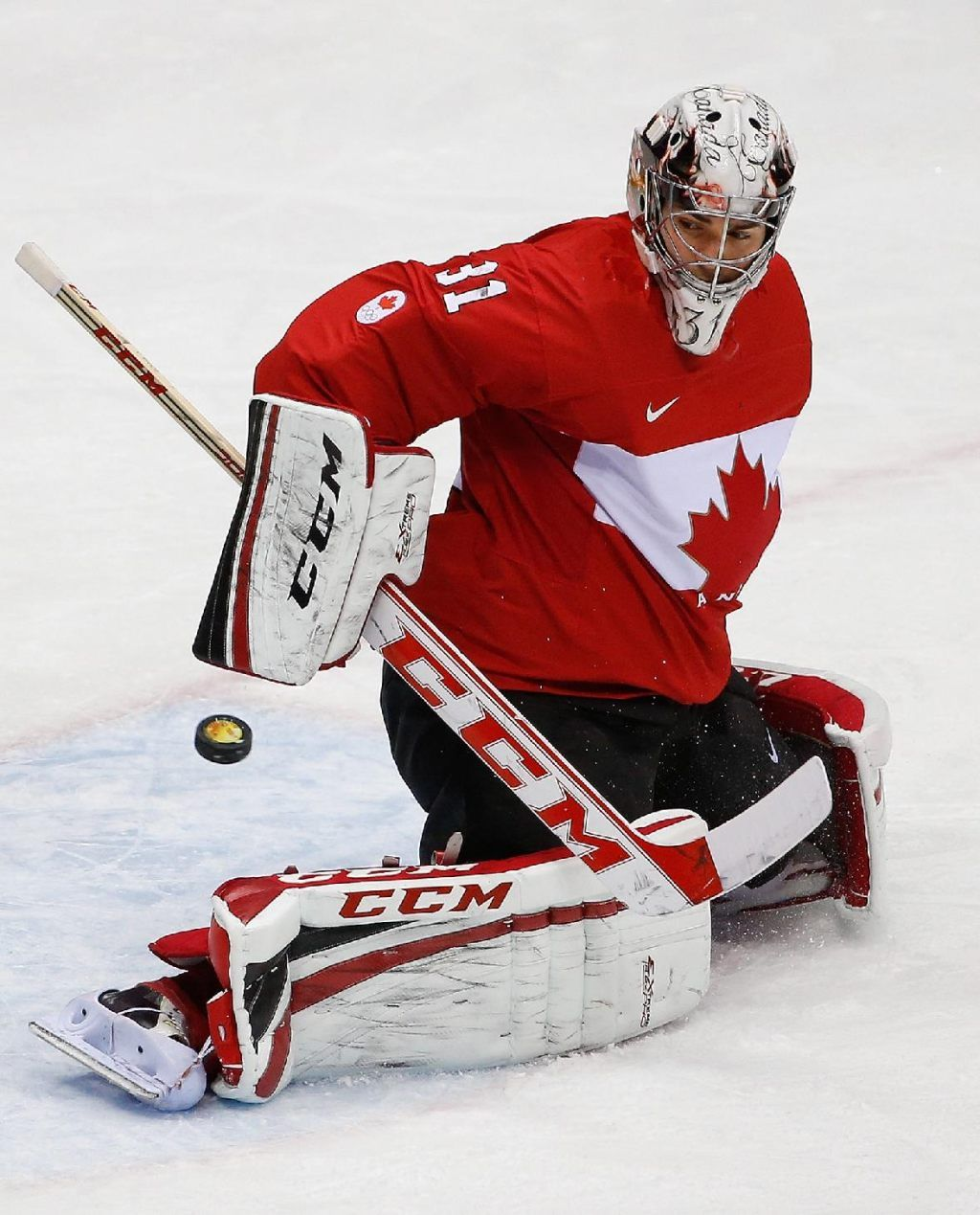 Carey Price blocks a shot on goal during the gold medal game against Sweden at the 2014 Winter Olympics. • AP Photo/Petr David Josek