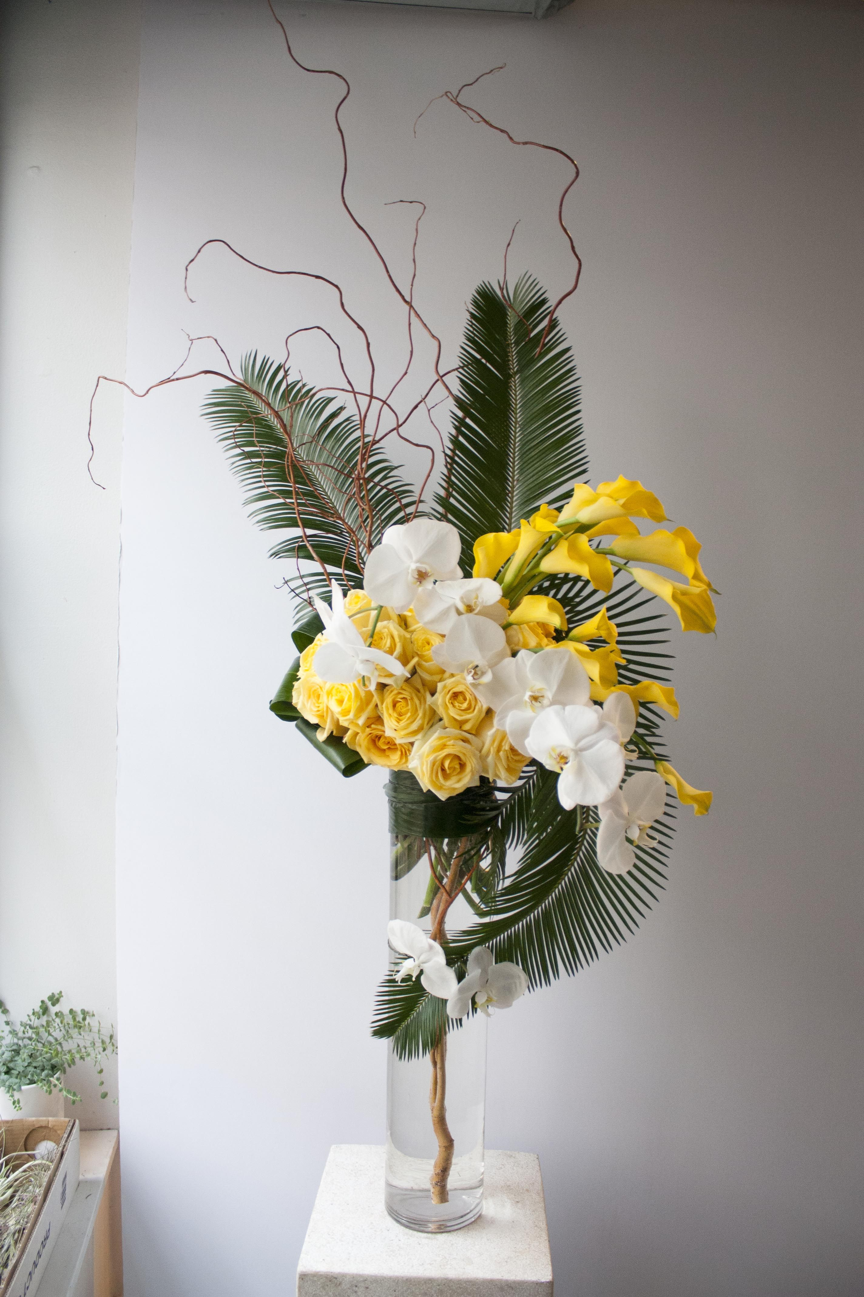 Tall and structural grouped floral arrangement for a