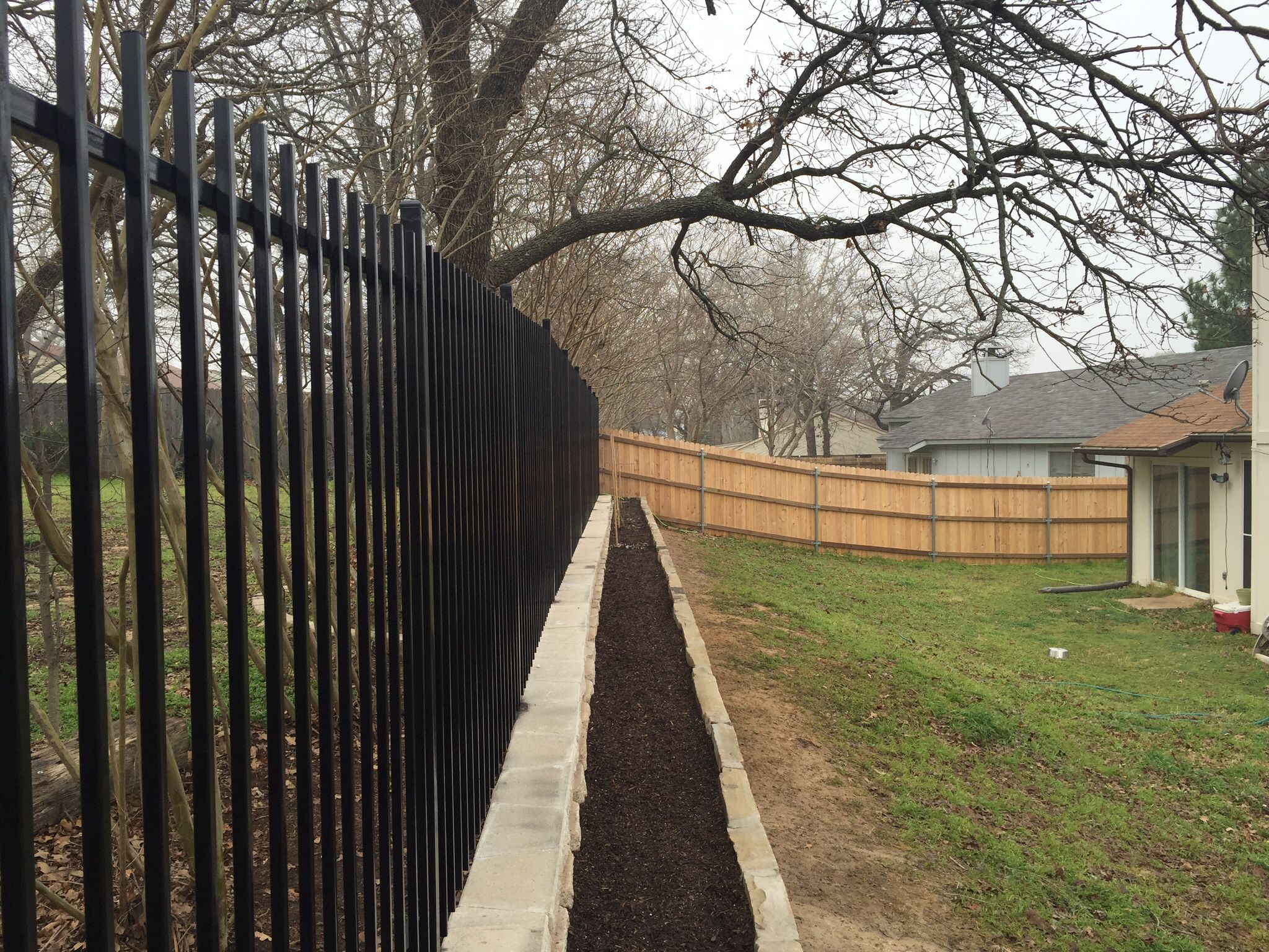fence build with two walls building a fence landscaping on types of walls construction id=29726