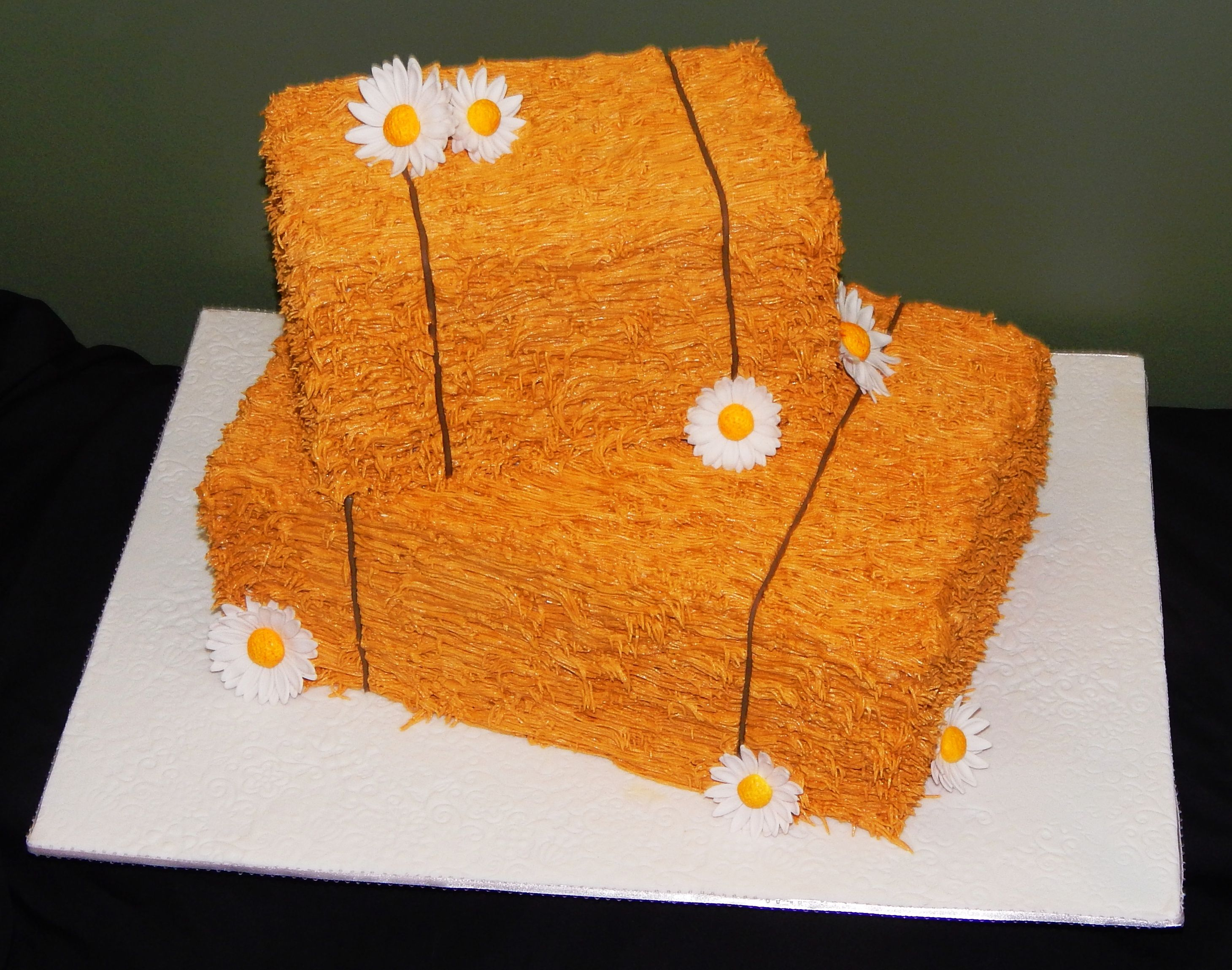 Cowboy Country themed cake with burnt orange and purple