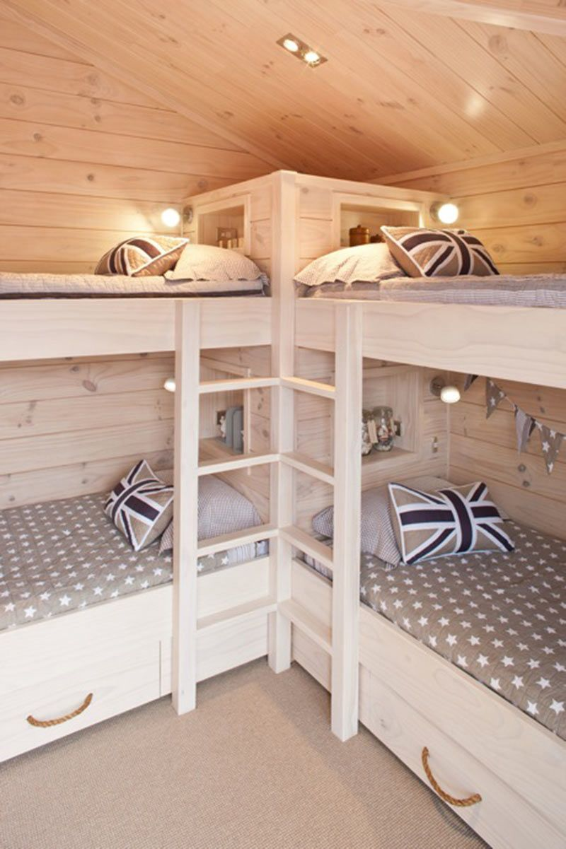 rustic country bunk room features builtin barnwood bunk beds dressed in yellow bedding flanking a rustic bunk bed ladder illuminated by a wood geou2026