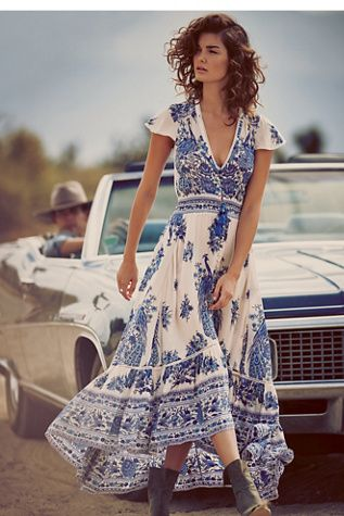 Bluebird Dress | Free People Sweeping, semi sheer maxi dress featuring a V-neckline and cap sleeves with subtle crochet detailing.