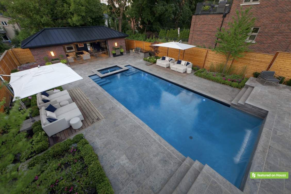 Pools on a sloped lot it 39 s hard to get bored in this for Pool design for sloped yard