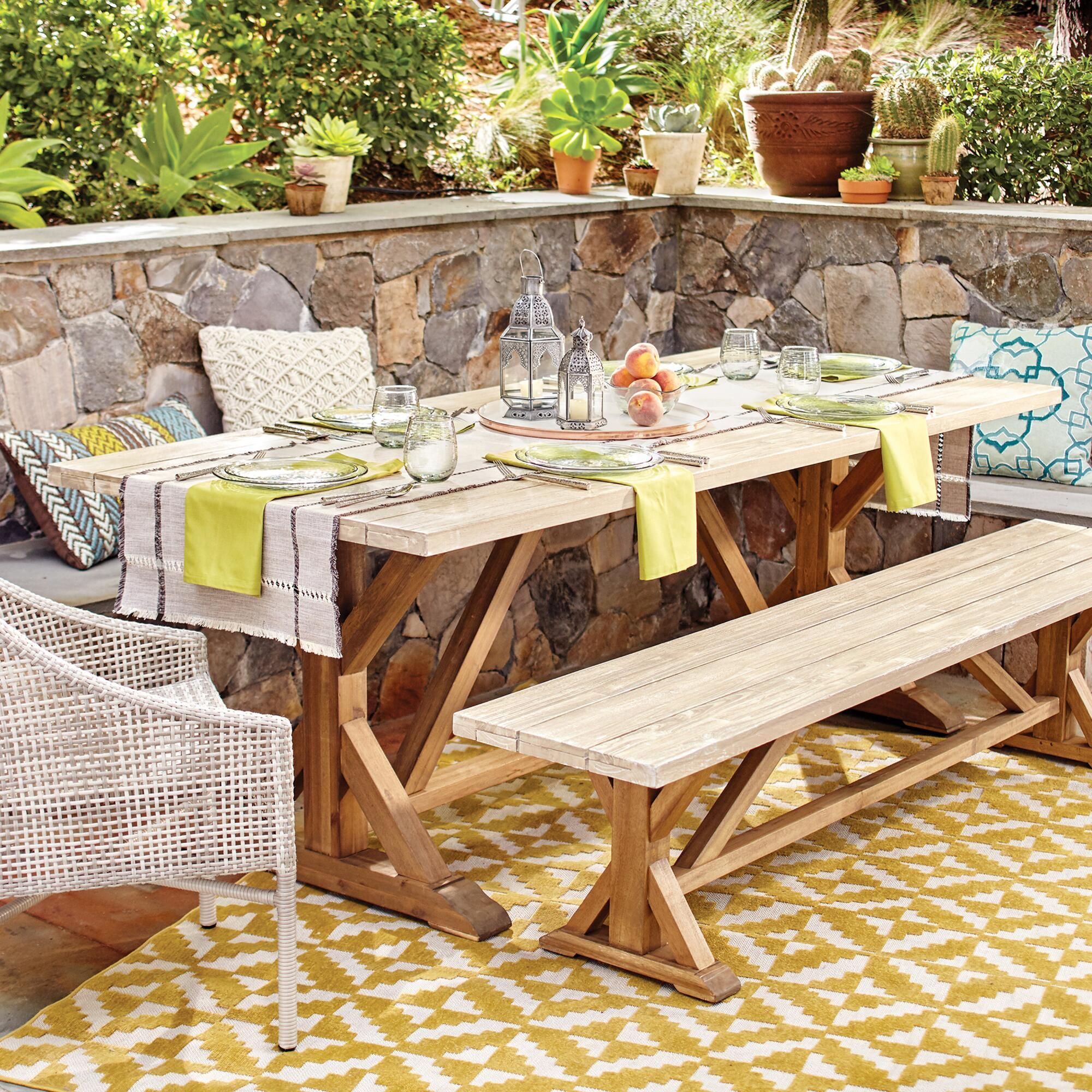 Our outdoor dining collection is fit for a sizeable soiree it features an extra long dining table and a dining bench both crafted of acacia wood with a