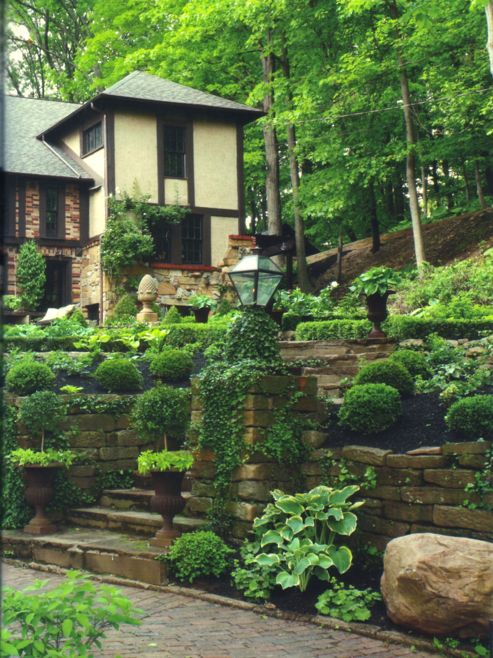 Boxwood Spheres Line The Hand Cut Stone Walls