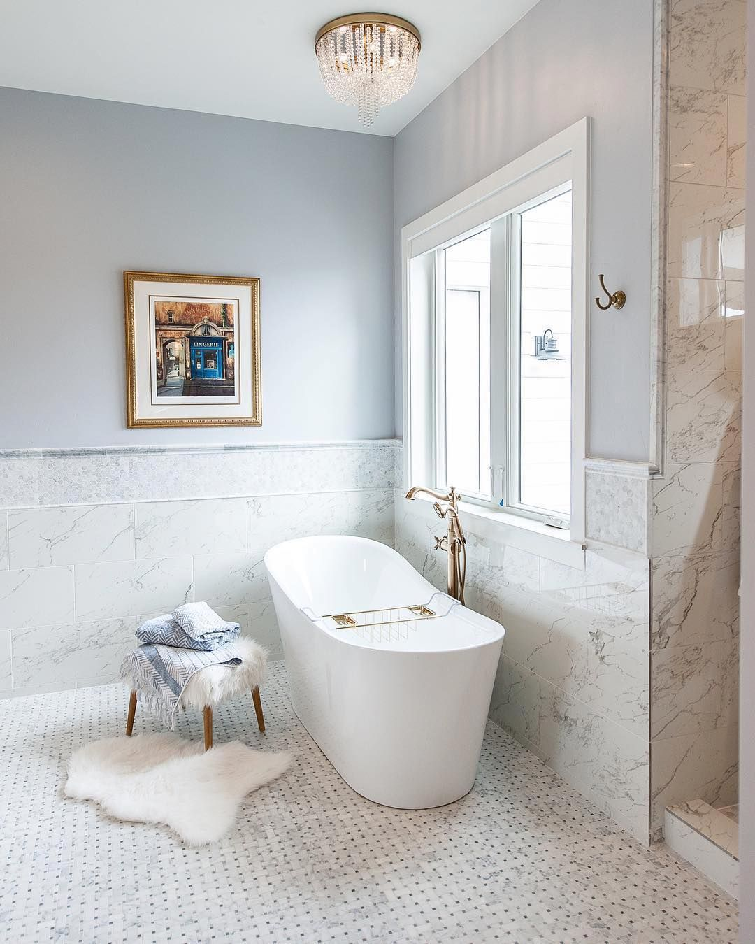 A Dreamy Bathroom Featuring Carrara Marble Tile That Gorgeous Tub