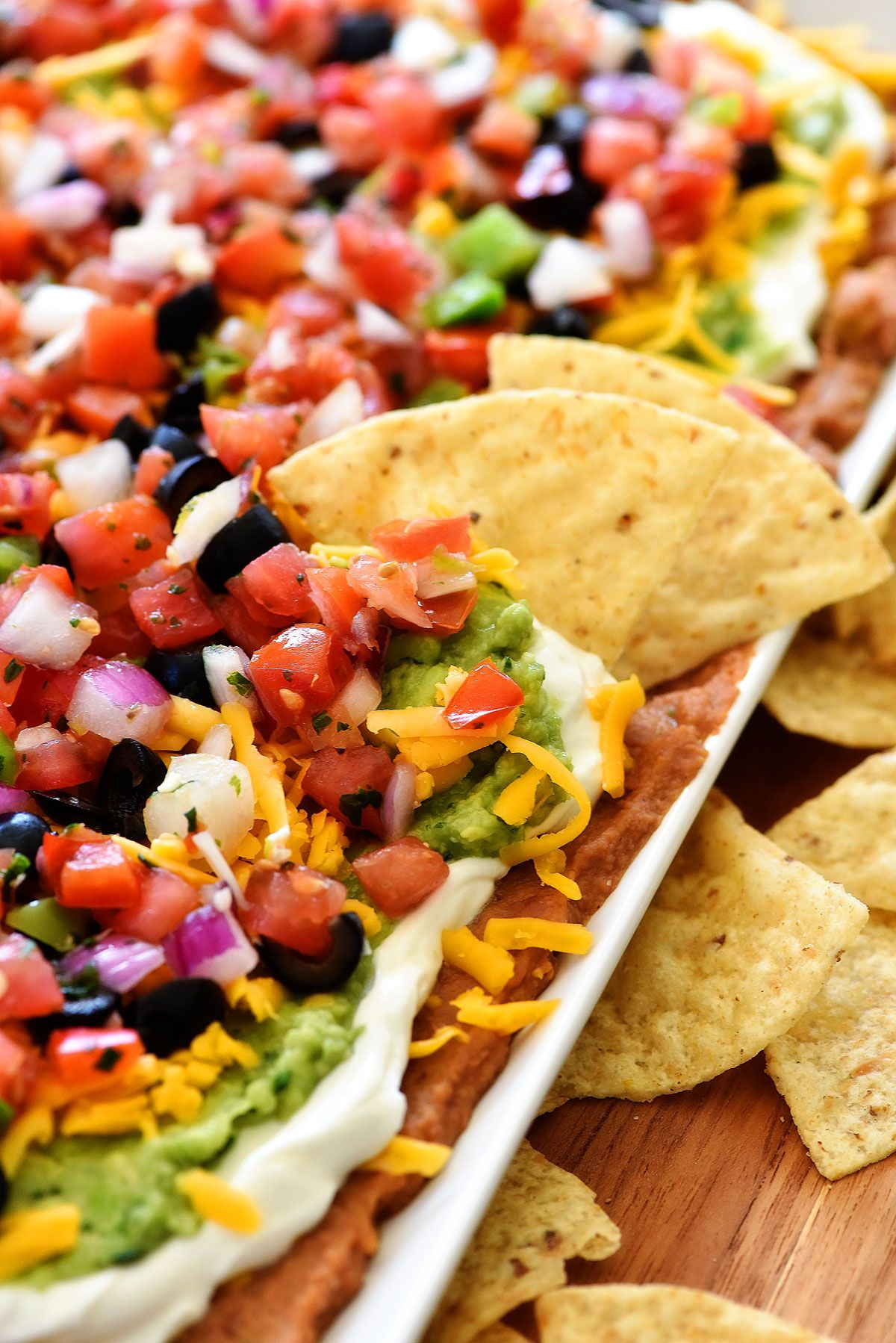 Make this Mexican Layer Dip for your next party or gathering! Just make sure to stock up on extra chips because you'll need them for this amazing dip!