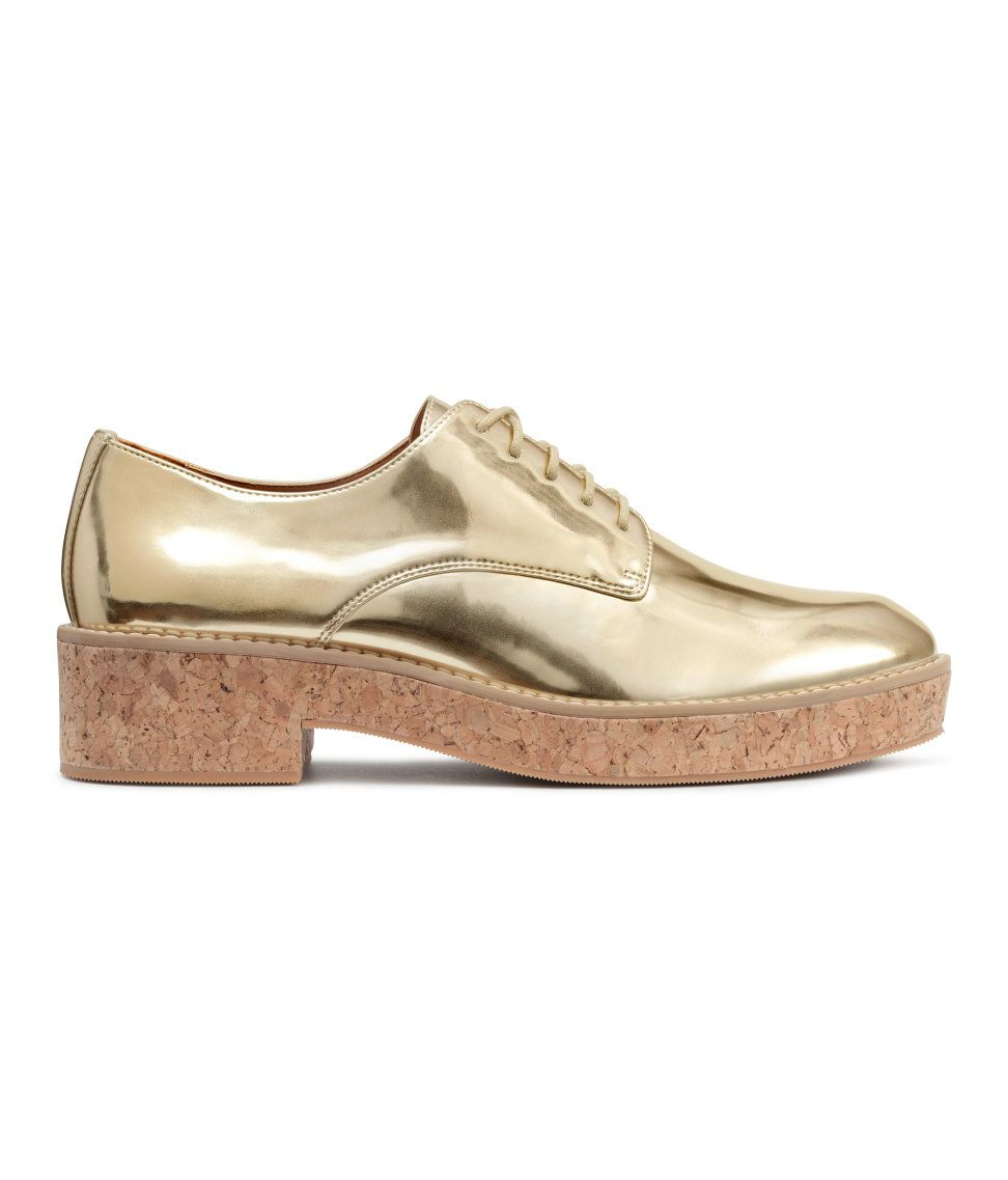 Platform shoes in imitation leather with a gold-colored ...