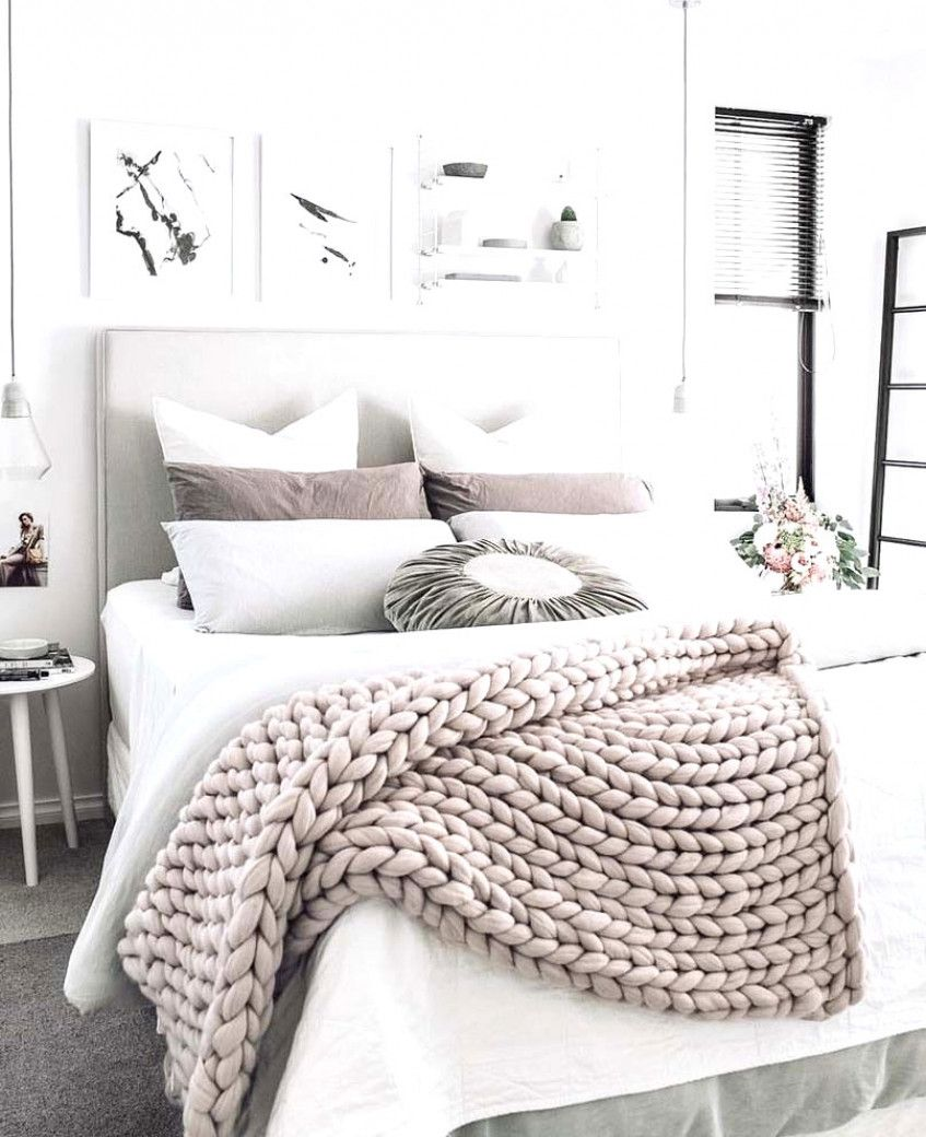 A Chunky Knit Wool Throw Adds Texture And Interest To A Gray And