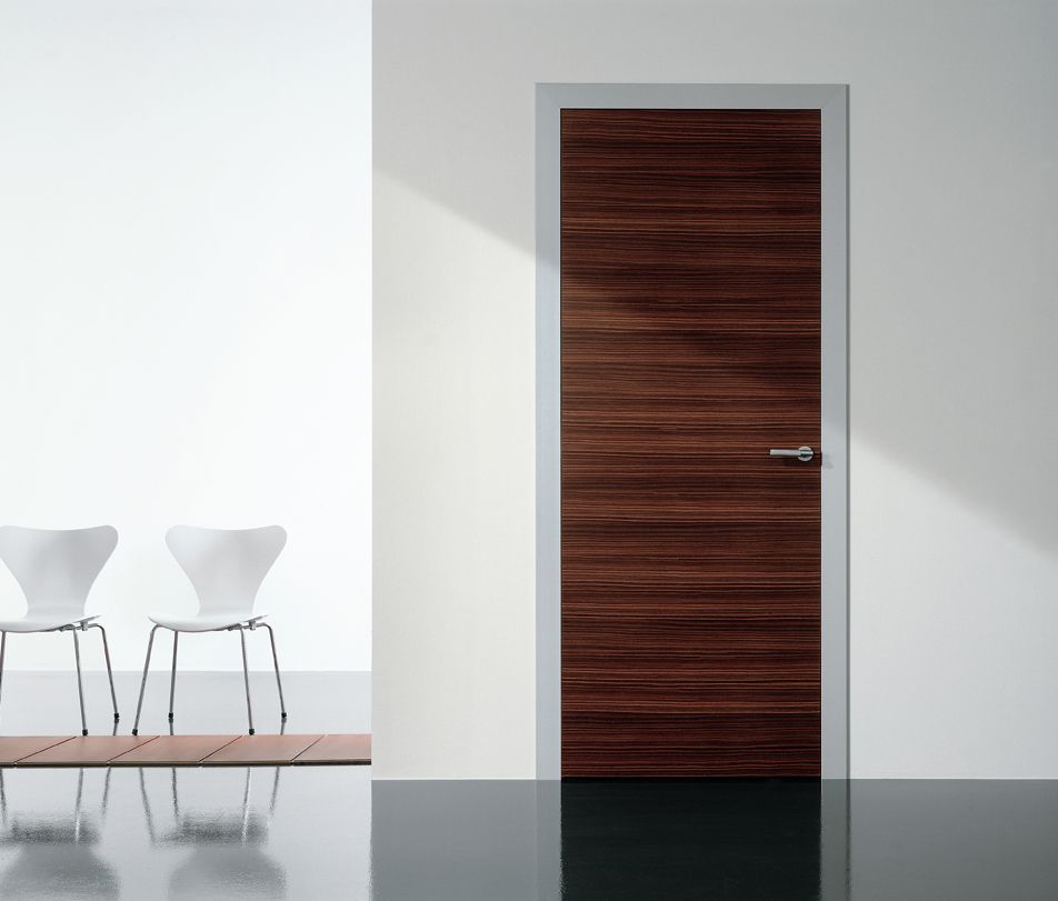 Modern interior swing door featuring a wood slab panel Modern glass doors interior