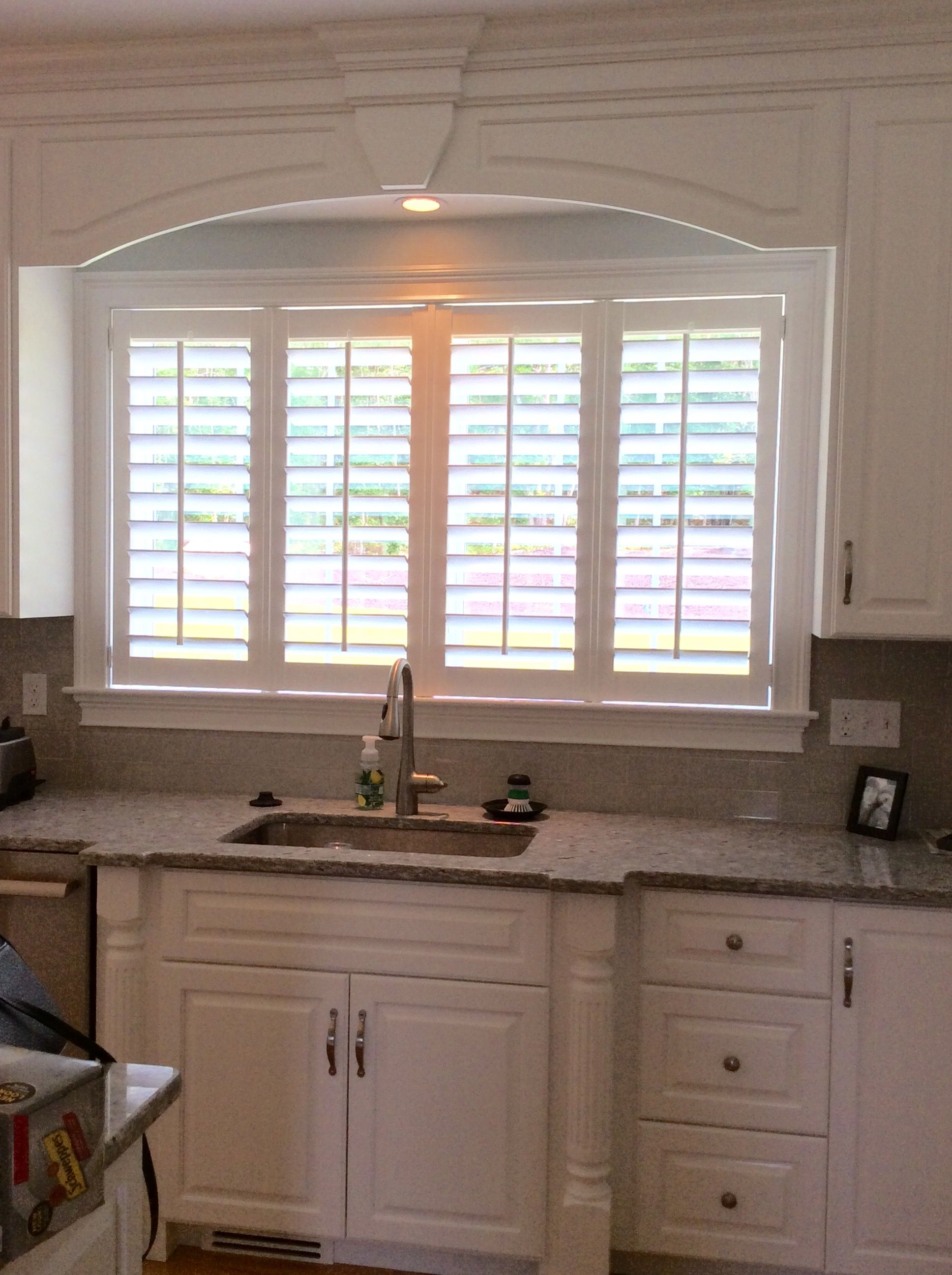 White Composite Wood Shutters Are A Great Solution Behind The