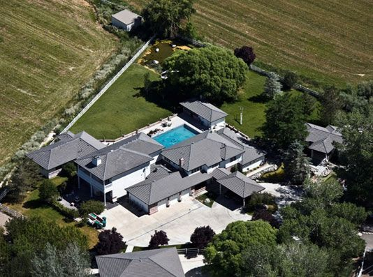 Reno - Find your own peace and serenity in this stunning 4.33 acre estate. A tree lined drive curves through lush lawns leading to the 5900+ sq. foot custom home. The home is built with passive solar heating. Slate floors lead through the spacious living room with gas fireplace and dining room to the gourmet kitchen, complete with custom counter tops, and everything needed for the happy cook. There are two family rooms, one with a fireplace the other with a pellet stove.
