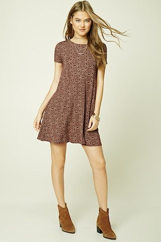 Style Deals - A knit mini dress featuring an abstract medallion print, a V-cutout back, a round neckline, short sleeves, and a swing silhouette.
