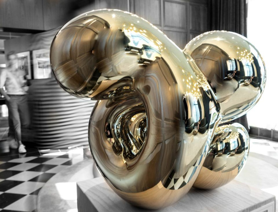 Mirrored steel sculptures by richard hudson on display at