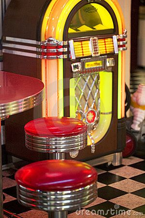 50 S Diner Decor Black White Checkerboard Tile Floor Juke Box And Vintage Bar Top Stools