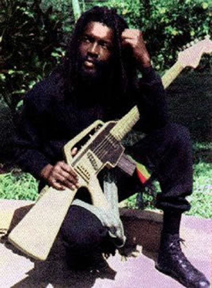 *Peter Tosh* and his M-16 guitar. More fantastic pictures and videos of *The Wailers* on: https://de.pinterest.com/ReggaeHeart/