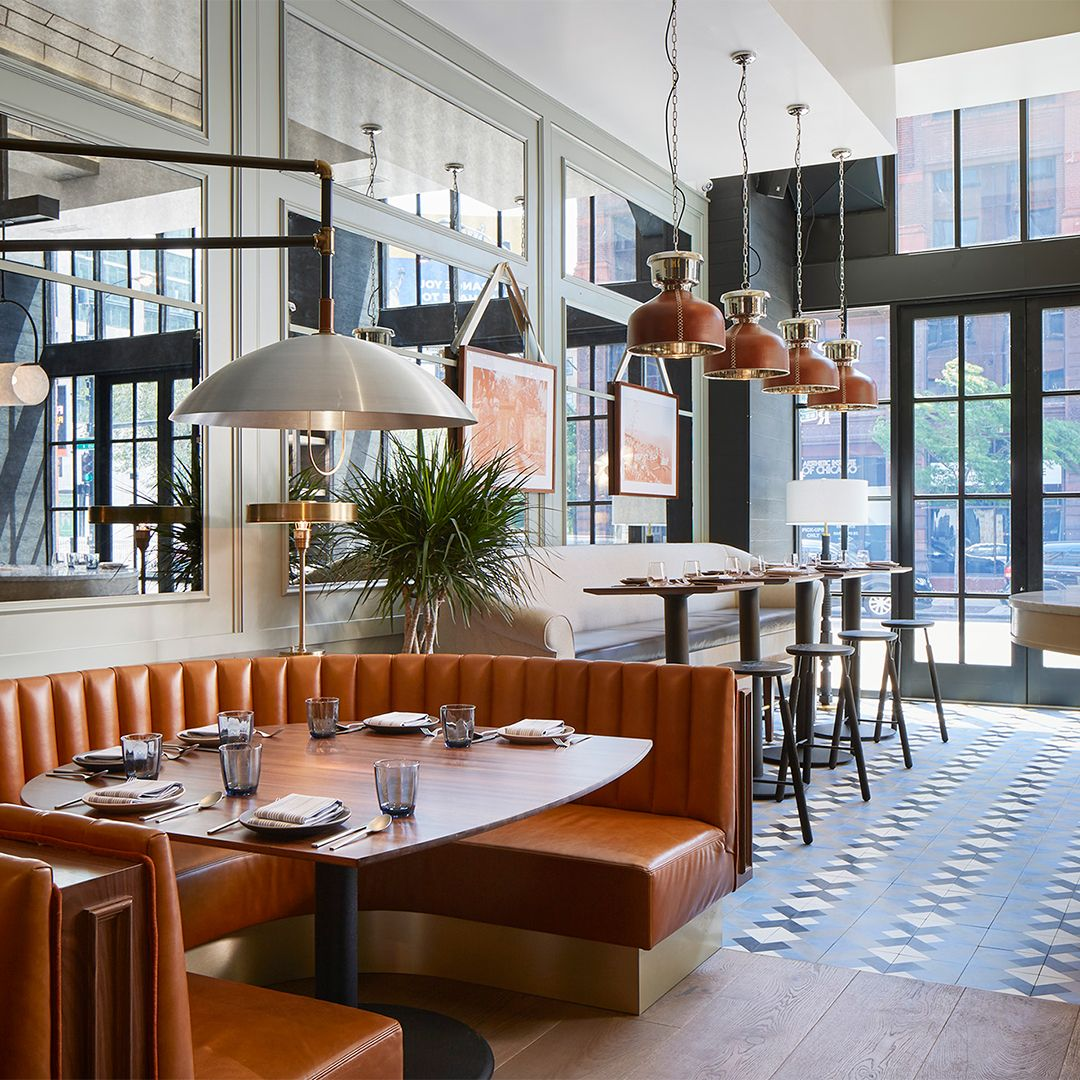 Leather booths in Proxi Restaurant in Chicago. Juniper manufactures lighting fixtures for home decor, office ideas, and restaurant interior. We created these custom swiveling dome-shaped pendants to illuminate the leather booths in this hospitality interior. #restaurantlighting #modernrestaurant #restaurantdesign #modernrestaurant