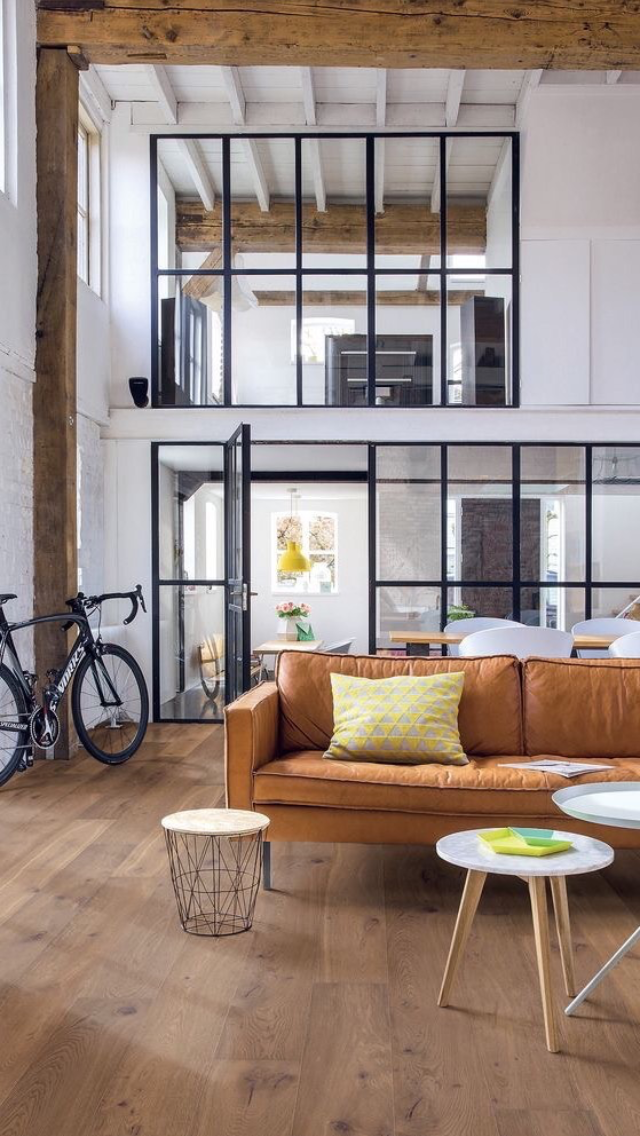 Beautifully Blends A Soft Industrial Interior Against Rustic Wood Elements