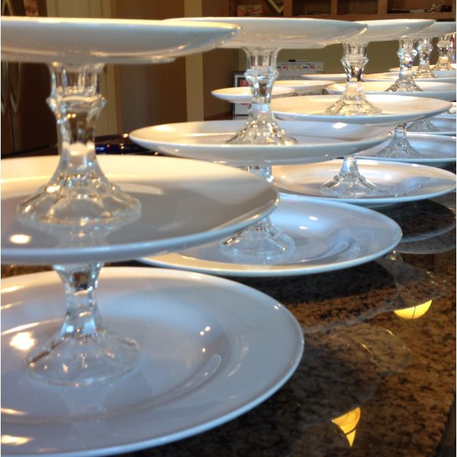 Three tiered cake plates as wedding centerpieces. They will be on each table decorated with gifts, flowers and cupcakes for our guests. Thank you Ikea plates and Dollar Tree candlesticks. Created for almost $10 less than renting than renting a tiered cake plate. :)