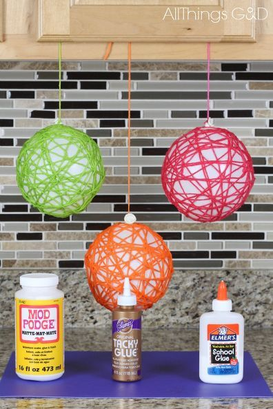 how to make yarn ball ornaments, christmas decorations, seasonal holiday decor (I've seen these done with string, too ... then sprayed with glitter.)