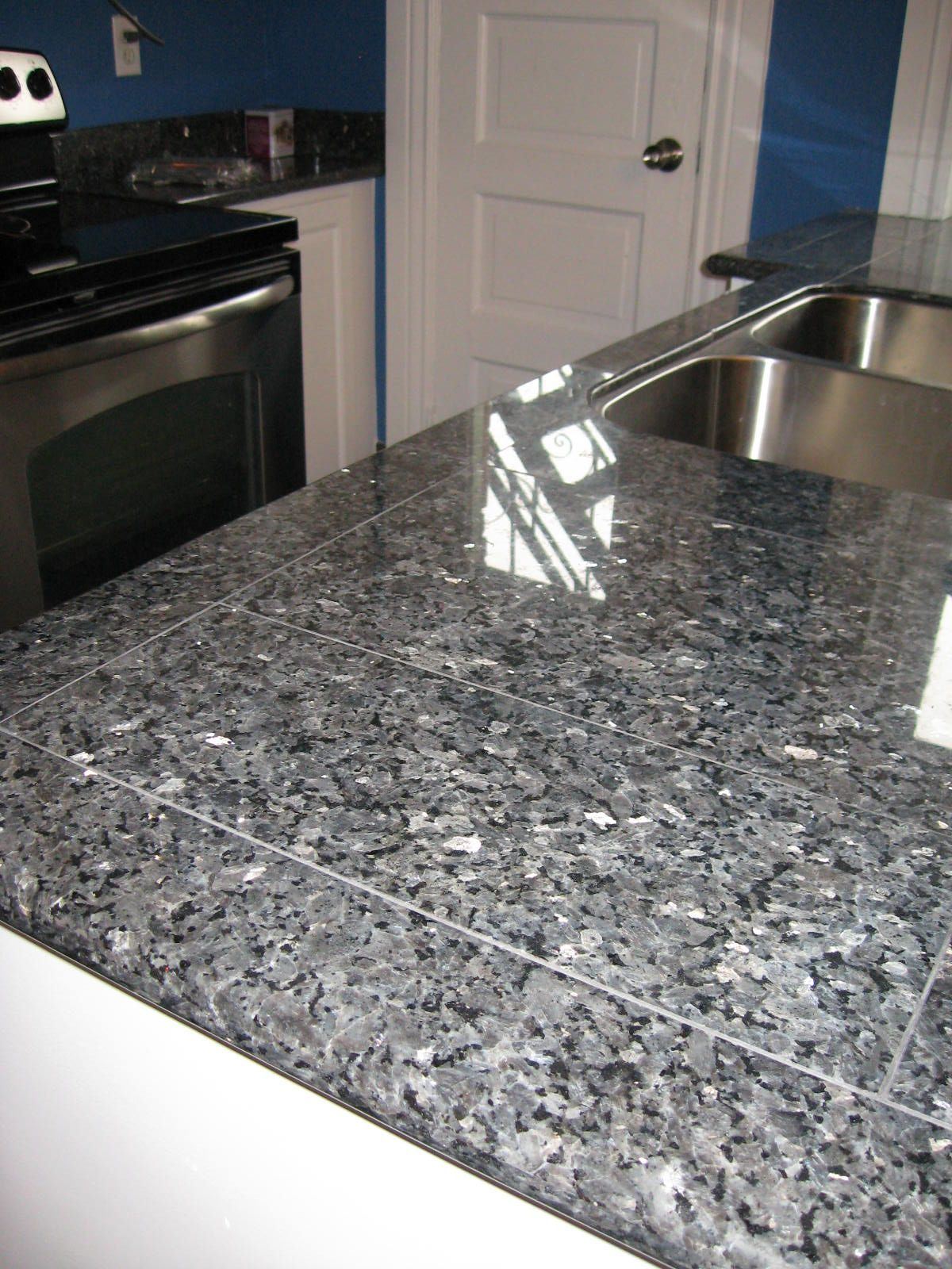 Kitchen Countertop Finished With Blue Pearl Lazy Granite Sysytem