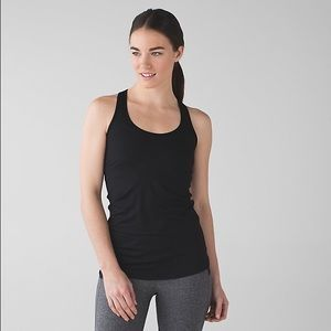 I just discovered this while shopping on Poshmark: Lululemon Cool Racerback Tank in Black. Check it out! Price: $32 Size: 6