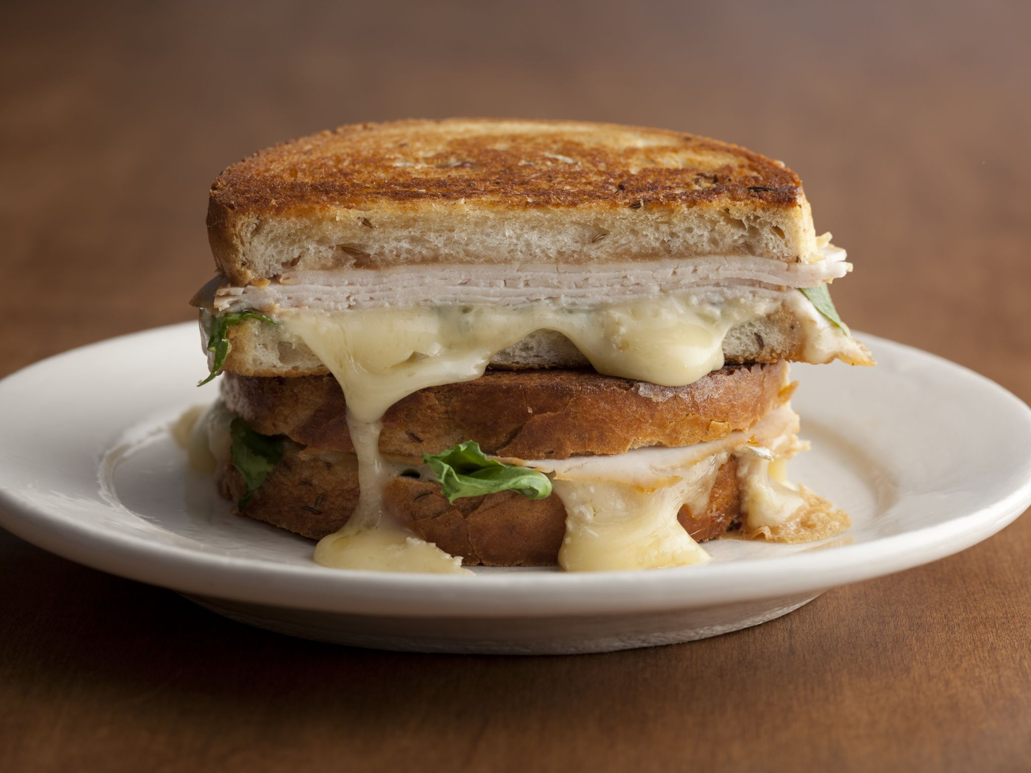 Tyler Florence Turkey grilled turkey, brie, and apple butter sandwich with arugula