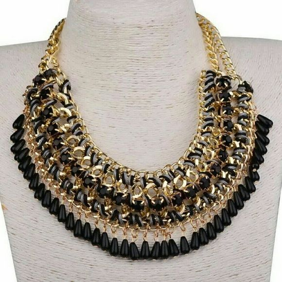 TRIPLE GOLDTONE BLACK DROP STATEMENT NECKLACE A chunky triple goldtone chain with black resin watee drop beads and stones. Jewelry Necklaces