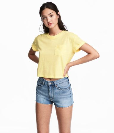c04d264b7434 Light yellow. Short jersey T-shirt with a chest pocket and sewn cuffs on  sleeves.