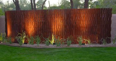 Floating undulations is an 18 foot long privacy screen for Pool privacy screen
