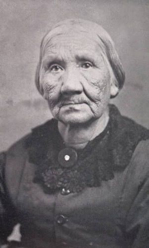 """Margaret Grey-Eyes """"Mother"""" Solomon, last Wyandot Indian, ca. 1880.  She attended the first school on the reservation, established by missionary John Stewart. In July 1843, the tribe was  relocated to Kansas City, Kansas. She and her second husband, John Solomon, returned to live in Upper Sandusky, Ohio, around 1865. Margaret's work in the Wyandot community earned her the nickname """"Mother Solomon."""""""