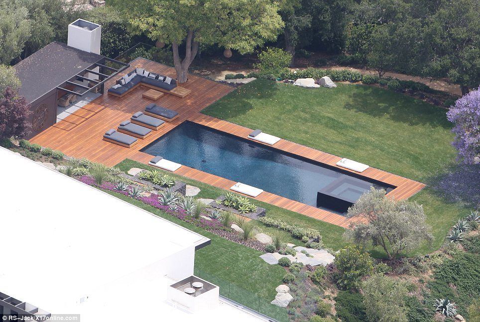 The perfect place for a dip: The mansion has a huge swimming pool with a giant deck for sunbathing