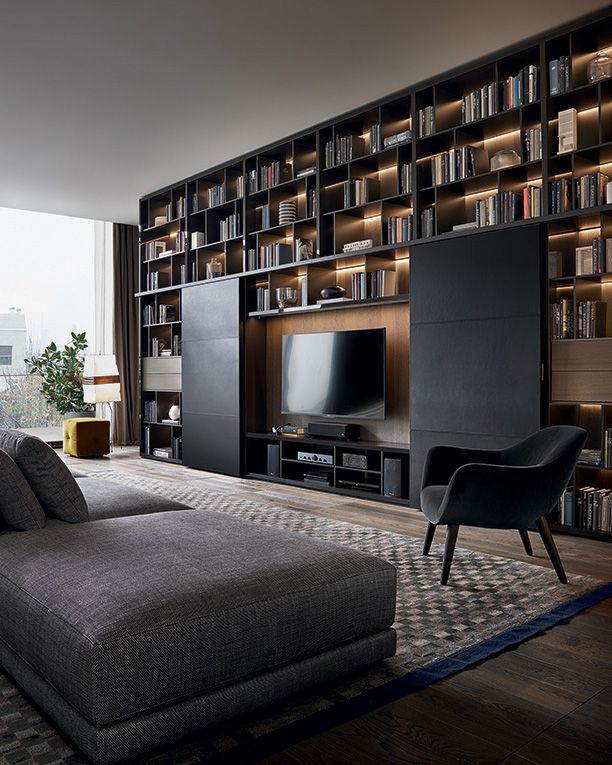 Wall System moka glossy lacquered, Bold sliding doors in black hide and guide rail moka mat lacquered.