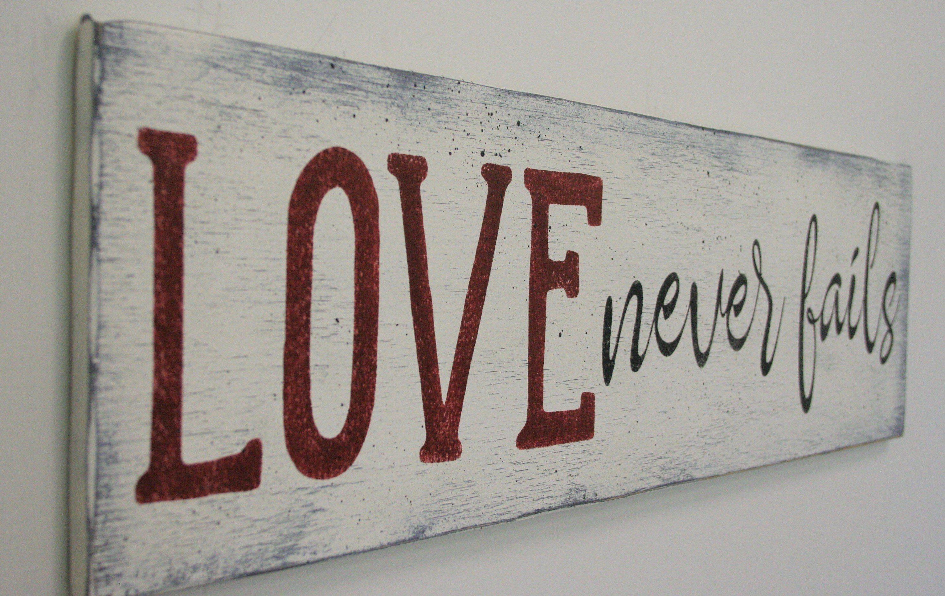 Love Never Fails Wood Sign Home Decor