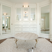 Ali Schwarz Design Group Closets Walk In Closet Linen Ottoman Tufted Beige Rug Mirrored Cabinets Doo