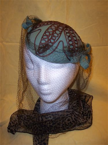 Sophisticated Sass!  Aqua Felt Hat with  Self Fabric Side Bows.  Full Face Brown Net. Stitched Brown Braid. Quality Ladies' Hat. $60.00