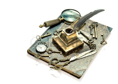 antique keys, pocket watch, ink pen, loupe, book isolated on white . collectibles and vintage goods. retro style toned picture
