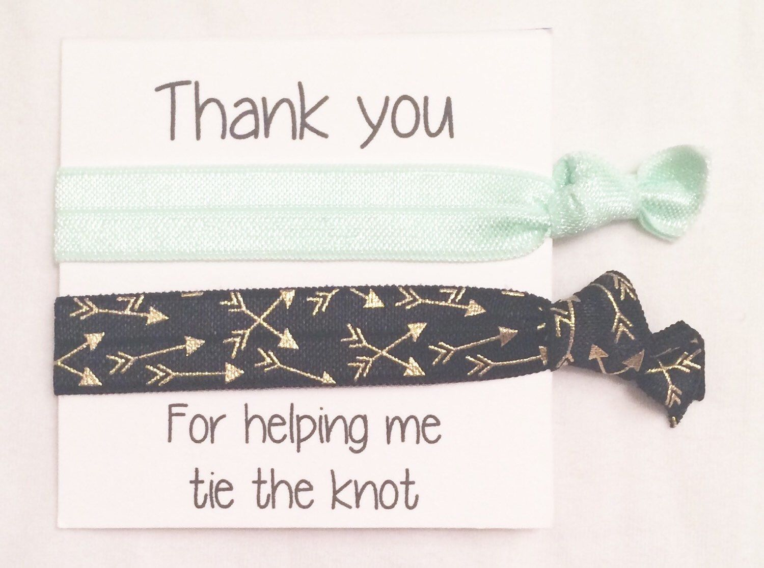 A personal favorite from my Etsy shop https://www.etsy.com/listing/253049588/bridesmaid-hair-tie-favorsolid-pale-mint