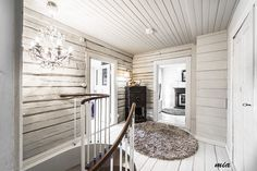 Scandinavian log cabin with the interior log walls pained white= Beautiful and airy!